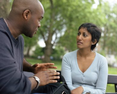 IStock_interracialmanandwoman talkingll